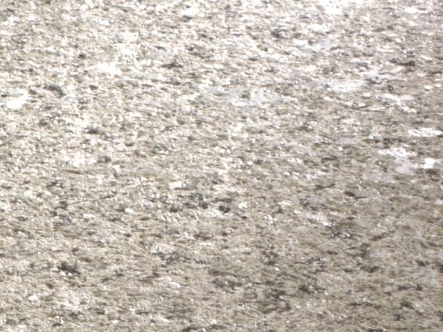 Percoco's Bushhammer finish shown on a piece of Ubatuba granite