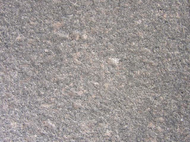 Percoco's Flame finish shown on a piece of Dakota Mahogany granite