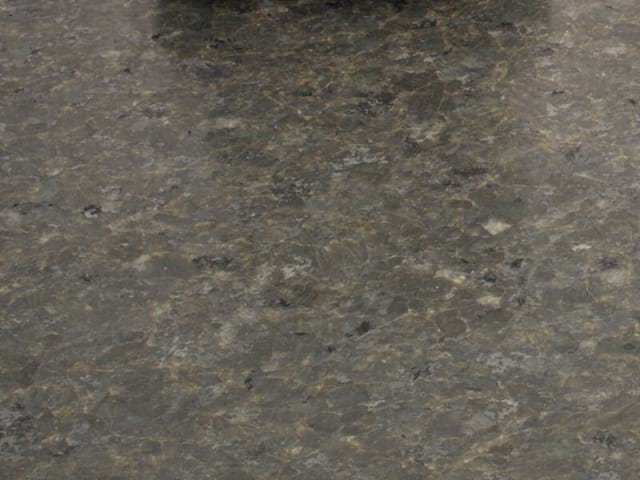 Percoco's Hone finish shown on a piece of Ubatuba granite