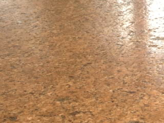 Percoco's Leather finish shown on a piece of Brown Vincenza granite