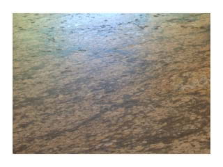 Percoco's Leather finish shown on a piece of Cobra Gold granite