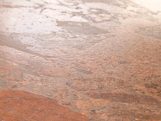 Percoco's Leather finish shown on a piece of Terracotta Bordeaux granite