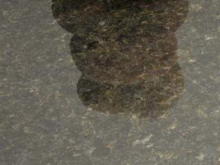The factory (done when the slabs are first cut) Polish finish shown on a piece of Ubatuba granite