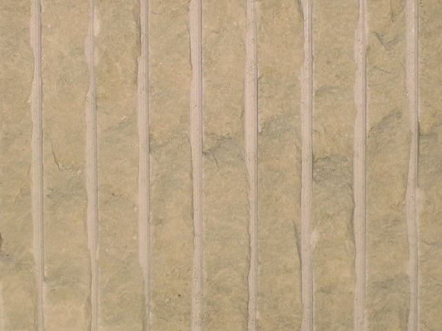Percoco's Rake (Coarse) finish shown on a piece of Crema Marfil marble
