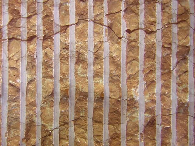 Percoco's Rake (Coarse) finish shown on a piece of Rosa Verona marble