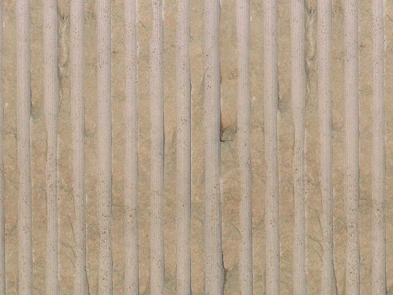 Percoco's Rake (Fine) finish shown on a piece of Crema Marfil marble