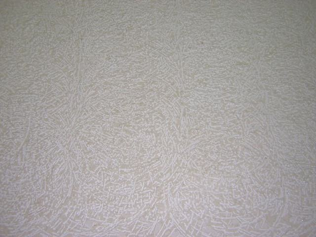 Percooc's Rustico finish shown on Crema Marfil Marble