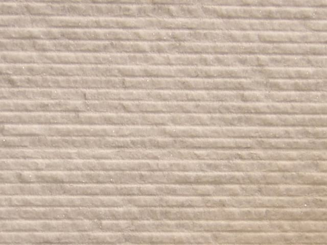 Percoco's Scarpaletto (Coarse) finish shown on a piece of White Carrara marble