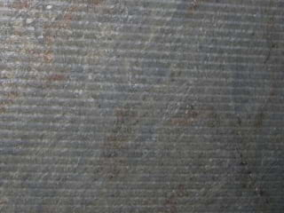 Percoco's Washboard finish in a horizontal orientation shown on Jurassic Gold granite